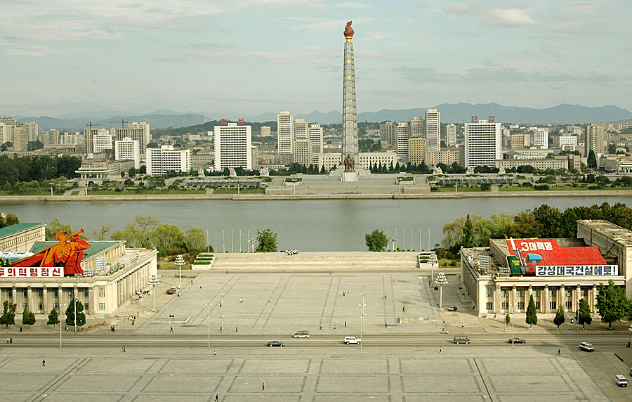Juche Tower over Taedong River in Pyongyang  by Ron Gluckman in North Korea