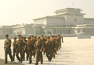 soldiers at Kim Il-Sung Kumsusan Mausolem  by Ron Gluckman in North Korea